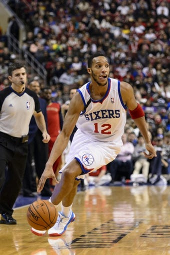 Nov 29, 2013; Philadelphia, PA, USA; Philadelphia 76ers guard Evan Turner (12) dribbles the ball during the third quarter against the New Orleans Pelicans at the Wells Fargo Center. The Pelicans defeated the Sixers 121-105. Mandatory Credit: Howard Smith-USA TODAY Sports