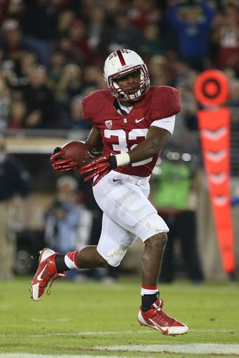 Nov 30, 2013; Stanford, CA, USA; Stanford Cardinal running back Anthony Wilkerson (32) scores a touchdown against the Notre Dame Fighting Irish during the third quarter at Stanford Stadium. The Stanford Cardinal defeated the Notre Dame Fighting Irish 27-20. Mandatory Credit: Kelley L Cox-USA TODAY Sports