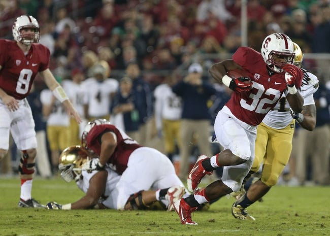 Nov 30, 2013; Stanford, CA, USA; Stanford Cardinal running back Anthony Wilkerson (32) carries the ball for a touchdown against the Notre Dame Fighting Irish during the third quarter at Stanford Stadium. The Stanford Cardinal defeated the Notre Dame Fighting Irish 27-20. Mandatory Credit: Kelley L Cox-USA TODAY Sports
