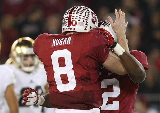 Nov 30, 2013; Stanford, CA, USA; Stanford Cardinal quarterback Kevin Hogan (8) celebrates with running back Anthony Wilkerson (32) after a touchdown against the Notre Dame Fighting Irish during the third quarter at Stanford Stadium. The Stanford Cardinal defeated the Notre Dame Fighting Irish 27-20. Mandatory Credit: Kelley L Cox-USA TODAY Sports