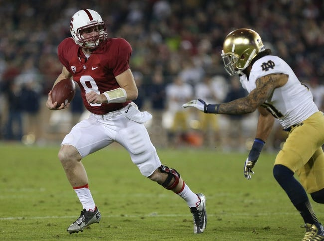 Nov 30, 2013; Stanford, CA, USA; Stanford Cardinal quarterback Kevin Hogan (8) elects to run against Notre Dame Fighting Irish safety Matthias Farley (41) during the third quarter at Stanford Stadium. The Stanford Cardinal defeated the Notre Dame Fighting Irish 27-20. Mandatory Credit: Kelley L Cox-USA TODAY Sports