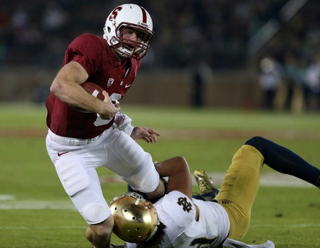 Nov 30, 2013; Stanford, CA, USA; Notre Dame Fighting Irish safety Matthias Farley (41) tackles Stanford Cardinal quarterback Kevin Hogan (8) during the third quarter at Stanford Stadium. The Stanford Cardinal defeated the Notre Dame Fighting Irish 27-20. Mandatory Credit: Kelley L Cox-USA TODAY Sports