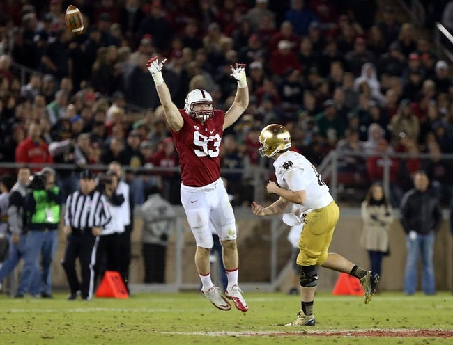Nov 30, 2013; Stanford, CA, USA; Stanford Cardinal linebacker Trent Murphy (93) tips the pass by Notre Dame Fighting Irish quarterback Tommy Rees (11) during the third quarter at Stanford Stadium. The Stanford Cardinal defeated the Notre Dame Fighting Irish 27-20. Mandatory Credit: Kelley L Cox-USA TODAY Sports