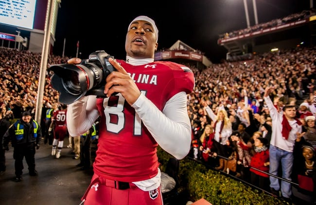 Nov 30, 2013; Columbia, SC, USA; South Carolina Gamecocks tight end Rory Anderson (81) takes photos following their 31-17 win over the Clemson Tigers at Williams-Brice Stadium. Mandatory Credit: Jeff Blake-USA TODAY Sports