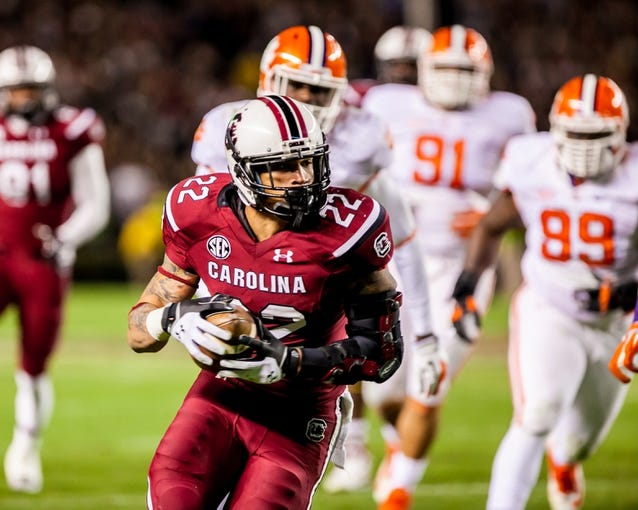 Nov 30, 2013; Columbia, SC, USA; South Carolina Gamecocks running back Brandon Wilds (22) makes a touchdown reception against the Clemson Tigers in the second half at Williams-Brice Stadium. Mandatory Credit: Jeff Blake-USA TODAY Sports