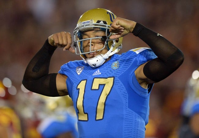 Nov 30, 2013; Los Angeles, CA, USA; UCLA Bruins quarterback Brett Hundley (17) celebrates after a touchdown in the first quarter against the Southern California Trojans at Los Angeles Memorial Coliseum. Mandatory Credit: Kirby Lee-USA TODAY Sports