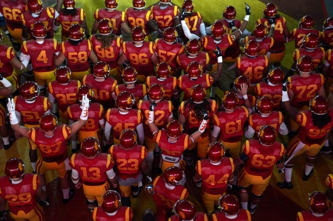 Nov 30, 2013; Los Angeles, CA, USA; Southern California Trojans players prepare to enter the field through the Los Angeles Memorial Coliseum tunnel before the game against the UCLA Bruins. Mandatory Credit: Kirby Lee-USA TODAY Sports