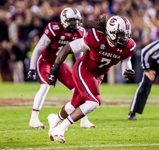 Nov 30, 2013; Columbia, SC, USA; South Carolina Gamecocks defensive end Jadeveon Clowney (7) rushes the passer against the Clemson Tigers in the second quarter at Williams-Brice Stadium. Mandatory Credit: Jeff Blake-USA TODAY Sports