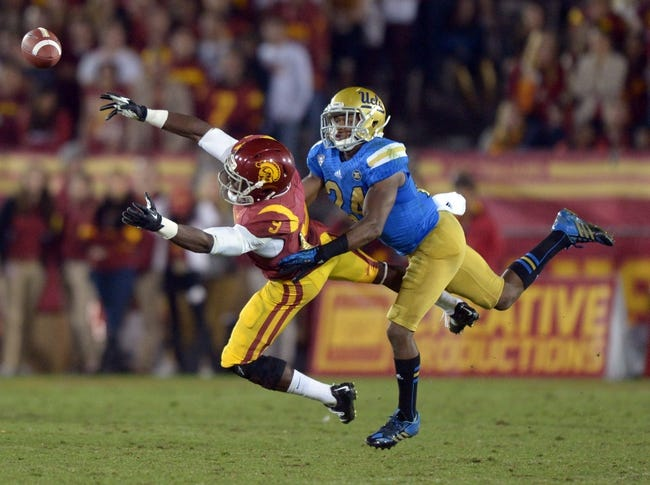 Nov 30, 2013; Los Angeles, CA, USA; Southern California Trojans receiver Marqise Lee (9) is defended by UCLA Bruins cornerback Ishmael Adams (24) at Los Angeles Memorial Coliseum. Mandatory Credit: Kirby Lee-USA TODAY Sports