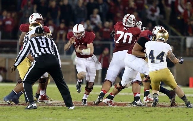 Nov 30, 2013; Stanford, CA, USA; Stanford Cardinal quarterback Kevin Hogan (8) runs against the Notre Dame Fighting Irish during the fourth quarter at Stanford Stadium. The Stanford Cardinal defeated the Notre Dame Fighting Irish 27-20. Mandatory Credit: Kelley L Cox-USA TODAY Sports