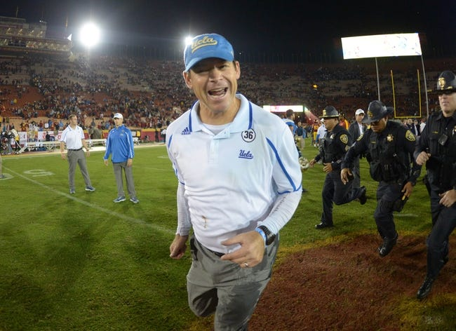 Nov 30, 2013; Los Angeles, CA, USA; UCLA Bruins coach Jim Mora celebrates at the end of the game against the Southern California Trojans at Los Angeles Memorial Coliseum. Mandatory Credit: Kirby Lee-USA TODAY Sports