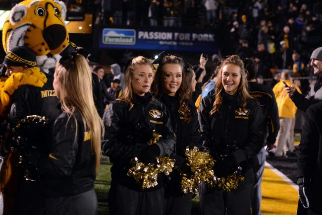 Nov 30, 2013; Columbia, MO, USA; Missouri Tigers mascot and cheerleaders celebrate after the game against the Texas A&M Aggies at Faurot Field. Missouri win 28-21. Mandatory Credit: Denny Medley-USA TODAY Sports