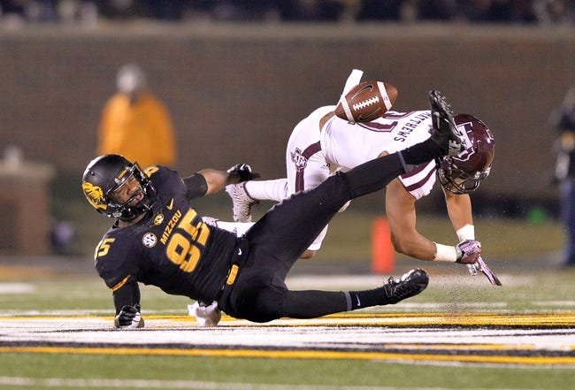 Nov 30, 2013; Columbia, MO, USA; Texas A&M Aggies defensive back kHoward Matthews (31) brakes up a pass intended for Missouri Tigers wide receiver Marcus Lucas (85) during the second half at Faurot Field. Missouri defeated Texas A&M 28-21. Mandatory Credit: Peter G. Aiken-USA TODAY Sports
