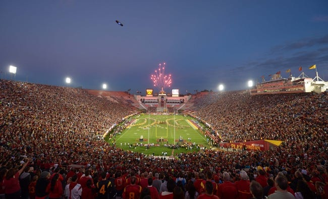 Nov 30, 2013; Los Angeles, CA, USA; General view of fireworks during the playing of the national anthem before the NCAA ootball game between the UCLA Bruins and the Southern California Trojans at the Los Angeles Memorial Coliseum. Mandatory Credit: Kirby Lee-USA TODAY Sports