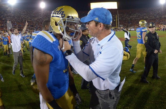 Nov 30, 2013; Los Angeles, CA, USA; UCLA Bruins coach Jim Mora (right) and receiver Shaquelle Adams (1) react at the end of the game against the Southern California Trojans t Los Angeles Memorial Coliseum. Mandatory Credit: Kirby Lee-USA TODAY Sports
