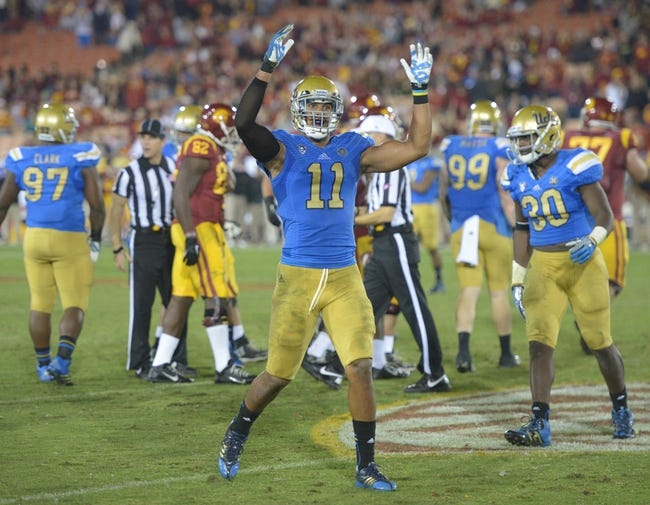 Nov 30, 2013; Los Angeles, CA, USA; UCLA Bruins linebacker Anthony Barr (11) celebrates after sacking Southern California Troans quarterback Cody Kessler (not pictured) in the fourth quarter at Los Angeles Memorial Coliseum. Mandatory Credit: Kirby Lee-USA TODAY Sports