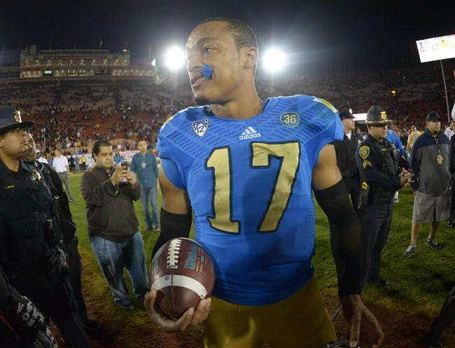 Nov 30, 2013; Los Angeles, CA, USA; UCLA Bruins quarterback Brett Hundley (17) walks off the field with the game ball after the game against the Southern California Trojans at Los Angeles Memorial Coliseum. Mandatory Credit: Kirby Lee-USA TODAY Sports