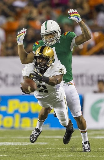 Nov 30, 2013; Honolulu, HI, USA; Army wide receiver Anthony Stephens (2) can't pull in a catch while being guarded by Hawaii defensive back Ne'Quan Phillips (1) during the second quarter at Aloha Stadium. Mandatory Credit: Marco Garcia-USA TODAY Sports