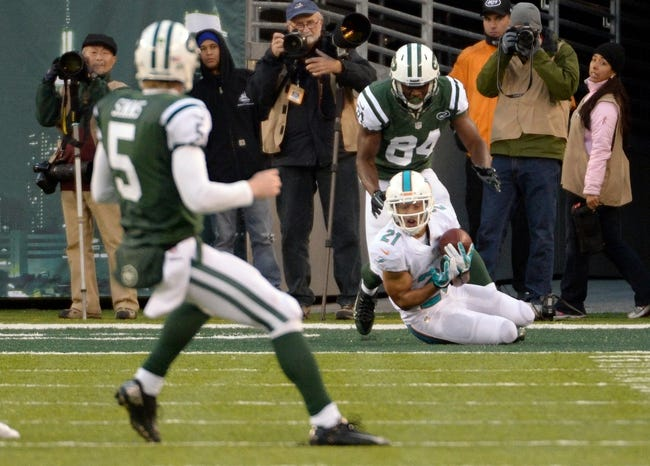 Dec 1, 2013; East Rutherford, NJ, USA; Miami Dolphins cornerback Brent Grimes (21) intercepts a pass from New York Jets quarterback Matt Simms (5) intended for wide receiver Stephen Hill during the game at MetLife Stadium. Mandatory Credit: Robert Deutsch-USA TODAY Sports