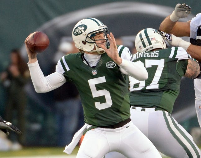 Dec 1, 2013; East Rutherford, NJ, USA; New York Jets quarterback Matt Simms (5) throws a pass against the Miami Dolphins during the game at MetLife Stadium. Mandatory Credit: Robert Deutsch-USA TODAY Sports