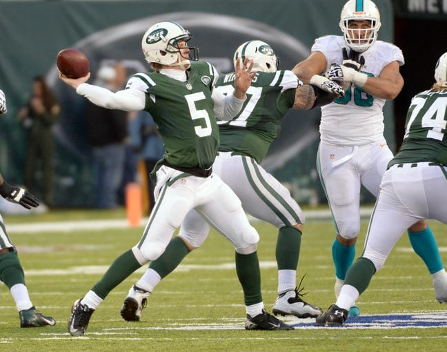 Dec 1, 2013; East Rutherford, NJ, USA; New York Jets quarterback Matt Simms (5) throws a pass against the Miami Dolphins in the second half during the game at MetLife Stadium. Mandatory Credit: Robert Deutsch-USA TODAY Sports