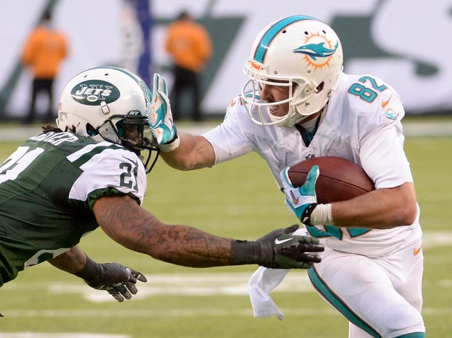 Dec 1, 2013; East Rutherford, NJ, USA; Miami Dolphins wide receiver Brian Hartline (82) is tackled by New York Jets defensive back Ellis Lankster (21) during the game at MetLife Stadium. Mandatory Credit: Robert Deutsch-USA TODAY Sports