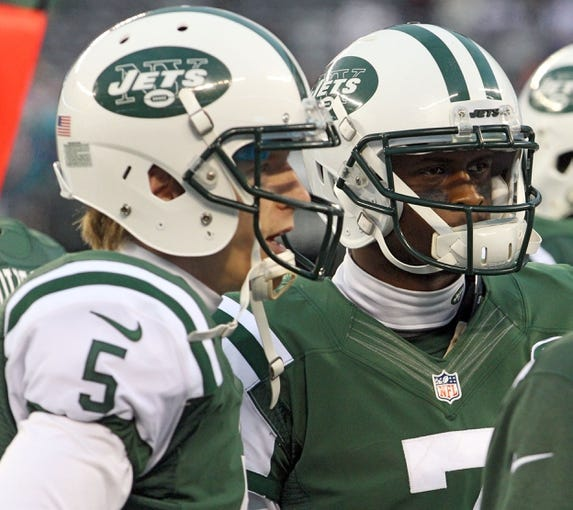 Dec 1, 2013; East Rutherford, NJ, USA; New York Jets quarterback Matt Simms (5) and quarterback Geno Smith (7) together on the sidelines during the fourth quarter of a game against the New York Jets at MetLife Stadium. Smith was benched for Simms for the second half. The Dolphins defeated the Jets 23-3. Mandatory Credit: Brad Penner-USA TODAY Sports