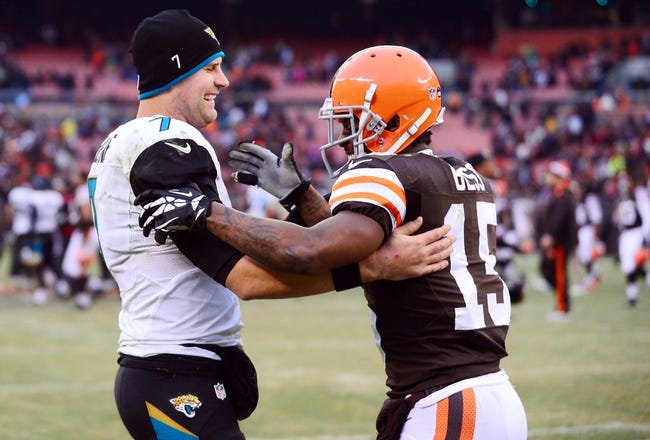 Dec 1, 2013; Cleveland, OH, USA; Jacksonville Jaguars quarterback Chad Henne (7) talks to Cleveland Browns wide receiver Davone Bess (15) following the game at FirstEnergy Stadium. Mandatory Credit: Andrew Weber-USA TODAY Sports