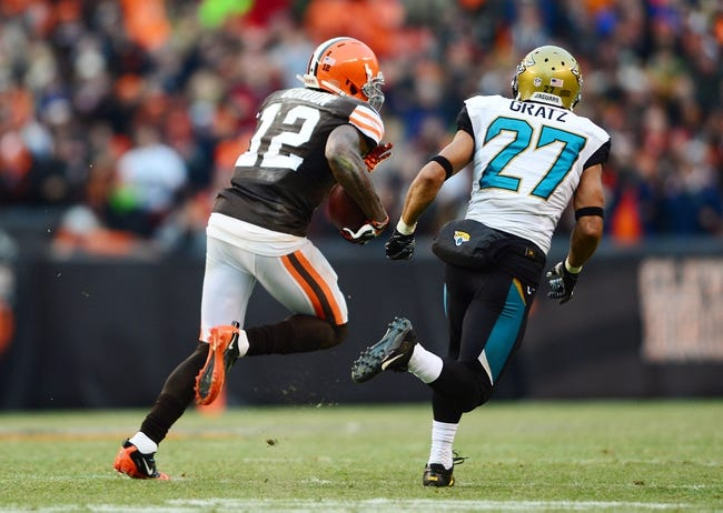 Dec 1, 2013; Cleveland, OH, USA; Cleveland Browns wide receiver Josh Gordon (12) gets away from Jacksonville Jaguars cornerback Dwayne Gratz (27) to score a touchdown in the fourth quarter at FirstEnergy Stadium. Mandatory Credit: Andrew Weber-USA TODAY Sports