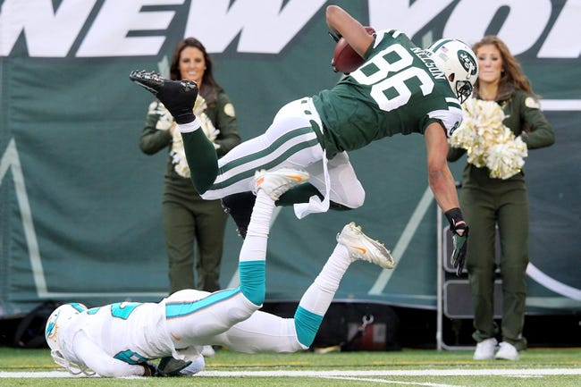 Dec 1, 2013; East Rutherford, NJ, USA; New York Jets wide receiver David Nelson (86) is tackled by Miami Dolphins corner back Will Davis (29) during the third quarter of a game at MetLife Stadium. The Dolphins defeated the Jets 23-3. Mandatory Credit: Brad Penner-USA TODAY Sports