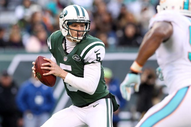Dec 1, 2013; East Rutherford, NJ, USA; New York Jets quarterback Matt Simms (5) drops back to pass against the Miami Dolphins during the third quarter of a game at MetLife Stadium. The Dolphins defeated the Jets 23-3. Mandatory Credit: Brad Penner-USA TODAY Sports