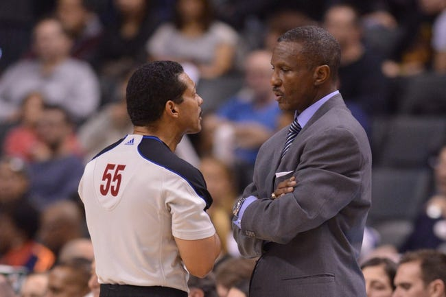 Dec 1, 2013; Toronto, Ontario, CAN; Toronto Raptors head coach Dwane Casey has a word with referee Bill Kennedy during the third quarter of a game against the Denver Nuggets at the Air Canada Centre. Denver won the game 112-98. Mandatory Credit: Mark Konezny-USA TODAY Sports