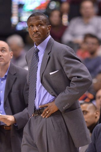 Dec 1, 2013; Toronto, Ontario, CAN; Toronto Raptors head coach Dwane Casey looks at the scoreboard during the third quarter of a game against the Denver Nuggets at the Air Canada Centre. Denver won the game 112-98. Mandatory Credit: Mark Konezny-USA TODAY Sports
