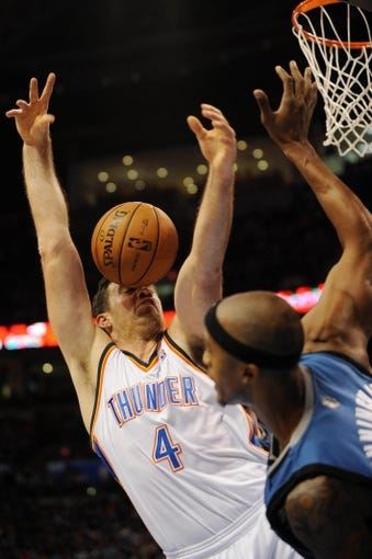 Dec 1, 2013; Oklahoma City, OK, USA; Oklahoma City Thunder power forward Nick Collison (4) attempts a shot against Minnesota Timberwolves small forward Corey Brewer (13) during the second quarter at Chesapeake Energy Arena. Mandatory Credit: Mark D. Smith-USA TODAY Sports