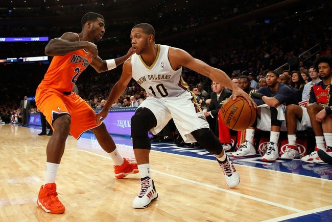 Dec 1, 2013; New York, NY, USA;  New Orleans Pelicans shooting guard Eric Gordon (10) drives around New York Knicks shooting guard Iman Shumpert (21) during the third quarter at Madison Square Garden. New Orleans Pelicans won 103-99.  Mandatory Credit: Anthony Gruppuso-USA TODAY Sports