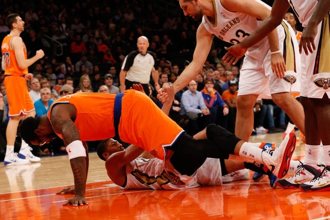 Dec 1, 2013; New York, NY, USA; New Orleans Pelicans power forward Anthony Davis (23) is helped up after being knocked over on a charge by New York Knicks power forward Amar'e Stoudemire (1) during the first quarter at Madison Square Garden. New Orleans Pelicans won 103-99.  Mandatory Credit: Anthony Gruppuso-USA TODAY Sports