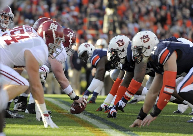 Nov 30, 2013; Auburn, AL, USA; Alabama Crimson Tide offensive linesman Chad Lindsay (78) prepares to snap the ball at the line of scrimmage against the Auburn Tigers at Jordan Hare Stadium. Mandatory Credit: RVR Photos-USA TODAY Sports