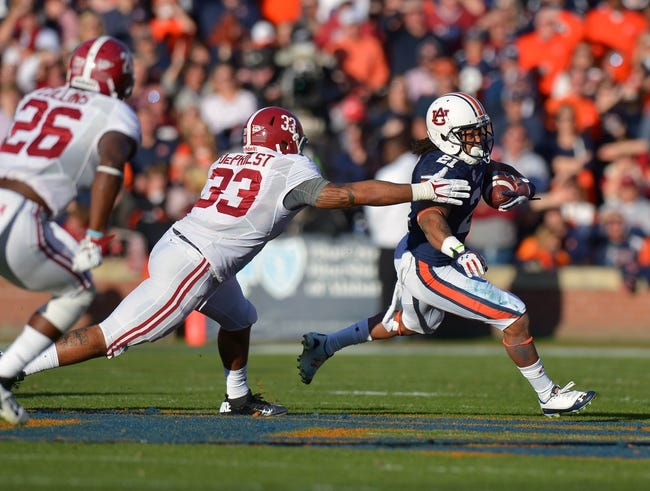 Nov 30, 2013; Auburn, AL, USA;  Auburn Tigers running back Tre Mason (21) carries the ball chased by Alabama Crimson Tide linebacker Trey DePriest (33) and defensive back Landon Collins (26) in the first quarter at Jordan Hare Stadium. Mandatory Credit: RVR Photos-USA TODAY Sports