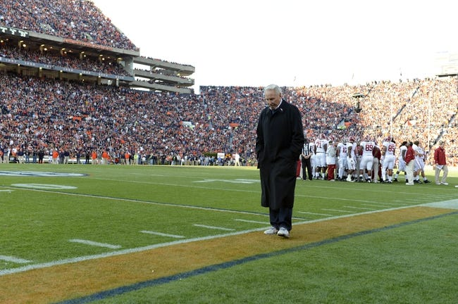 Nov 30, 2013; Auburn, AL, USA;  ESPN college football analyst Lee Corso paces the sideline at the game between the Alabama Crimson Tide and the Auburn Tigers at Jordan Hare Stadium. Mandatory Credit: RVR Photos-USA TODAY Sports