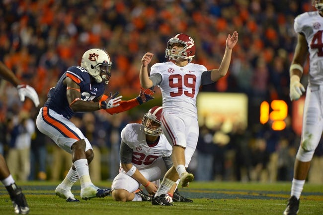 Nov 30, 2013; Auburn, AL, USA;  Alabama Crimson Tide kicker Adam Griffith (99) attempts a 57 yard field goal with 1.0 second remaining in the game which was returned 100 yards for a game winning touchdown by Auburn Tigers cornerback Chris Davis (not pictured) at Jordan Hare Stadium. Mandatory Credit: RVR Photos-USA TODAY Sports