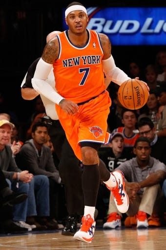 Dec 1, 2013; New York, NY, USA;  New York Knicks small forward Carmelo Anthony (7) during the second quarter against the New Orleans Pelicans at Madison Square Garden. New Orleans Pelicans won 103-99.  Mandatory Credit: Anthony Gruppuso-USA TODAY Sports