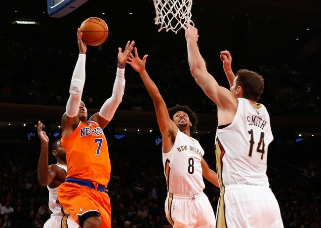 Dec 1, 2013; New York, NY, USA;  New York Knicks small forward Carmelo Anthony (7) shoots over New Orleans Pelicans small forward Josh Childress (8) and center Jason Smith (14) during the second quarter at Madison Square Garden. New Orleans Pelicans won 103-99.  Mandatory Credit: Anthony Gruppuso-USA TODAY Sports