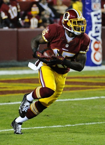 Dec 1, 2013; Landover, MD, USA; Washington Redskins wide receiver Josh Morgan (15) returns a kick against the New York Giants during the first half at FedEx Field. Mandatory Credit: Brad Mills-USA TODAY Sports