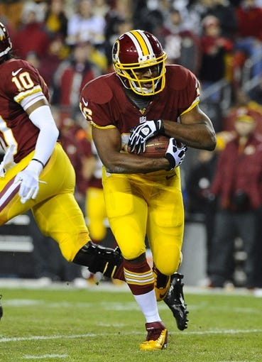 Dec 1, 2013; Landover, MD, USA; Washington Redskins running back Alfred Morris (46) rushes the ball against the New York Giants during the first half at FedEx Field. Mandatory Credit: Brad Mills-USA TODAY Sports