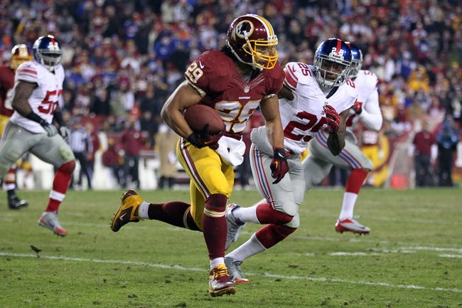 Dec 1, 2013; Landover, MD, USA; Washington Redskins running back Roy Helu (29) carries the ball as New York Giants free safety Will Hill (25) chases in the fourth quarter at FedEx Field. The Giants won 24-17. Mandatory Credit: Geoff Burke-USA TODAY Sports