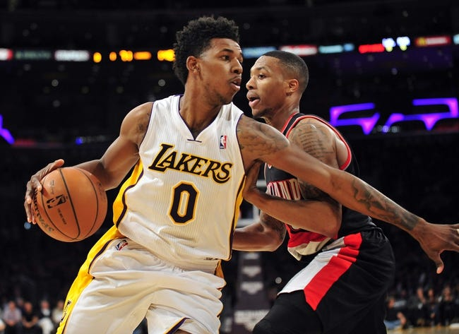 December 1, 2013; Los Angeles, CA, USA; Los Angeles Lakers small forward Nick Young (0) moves to the basket against the Portland Trail Blazers during the second half at Staples Center. Mandatory Credit: Gary A. Vasquez-USA TODAY Sports