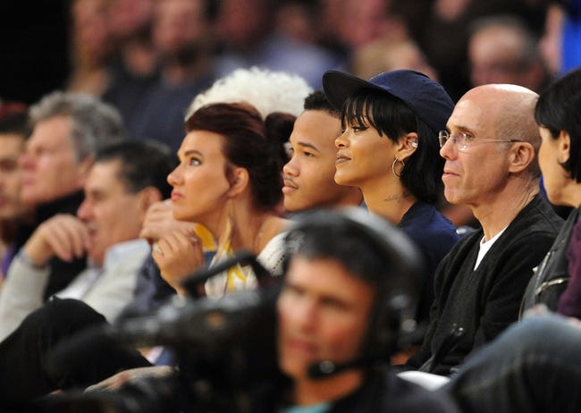 December 1, 2013; Los Angeles, CA, USA; Recording artist Rihanna and film executive Jeffrey Katzenberg in attendance as the Los Angeles Lakers play against the Portland Trail Blazers during the second half at Staples Center. Mandatory Credit: Gary A. Vasquez-USA TODAY Sports