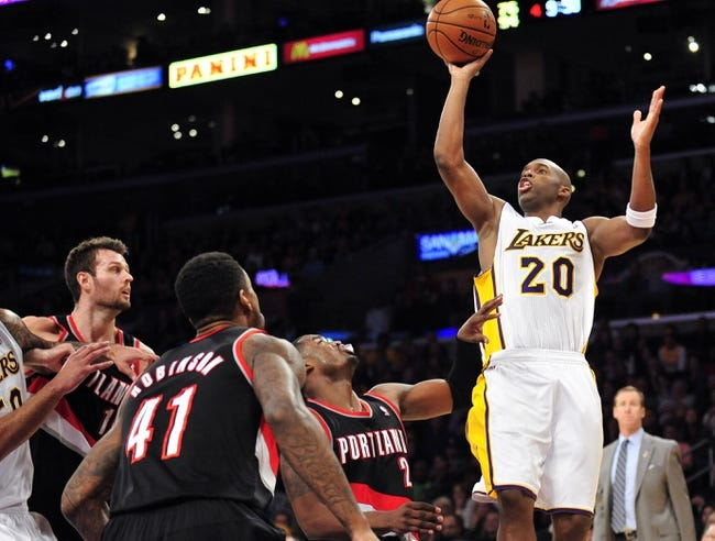 December 1, 2013; Los Angeles, CA, USA; Los Angeles Lakers shooting guard Jodie Meeks (20) shoots against the Portland Trail Blazers during the second half at Staples Center. Mandatory Credit: Gary A. Vasquez-USA TODAY Sports