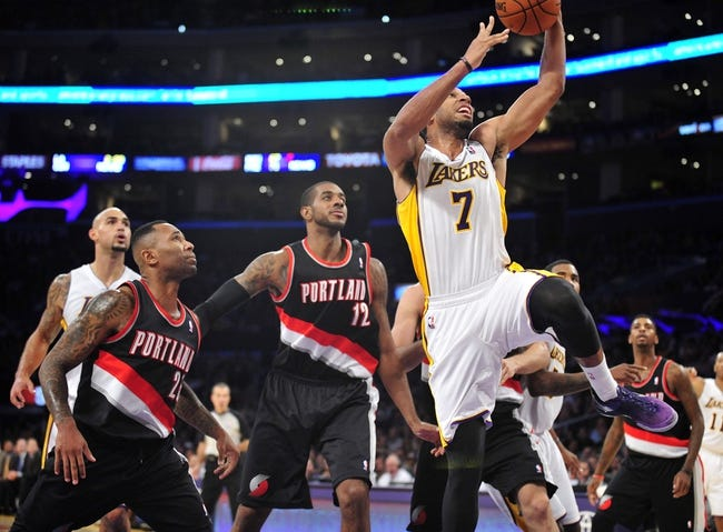 December 1, 2013; Los Angeles, CA, USA; Los Angeles Lakers small forward Xavier Henry (7) moves to the basket against the Portland Trail Blazers during the second half at Staples Center. Mandatory Credit: Gary A. Vasquez-USA TODAY Sports