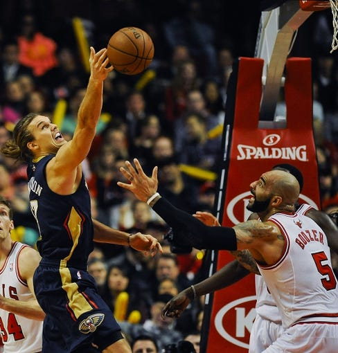 Dec 2, 2013; Chicago, IL, USA; New Orleans Pelicans power forward Lou Amundson (17) reaches for a rebound against Chicago Bulls power forward Carlos Boozer (5) during the first half of their game at the United Center.  Mandatory Credit: Matt Marton-USA TODAY Sports